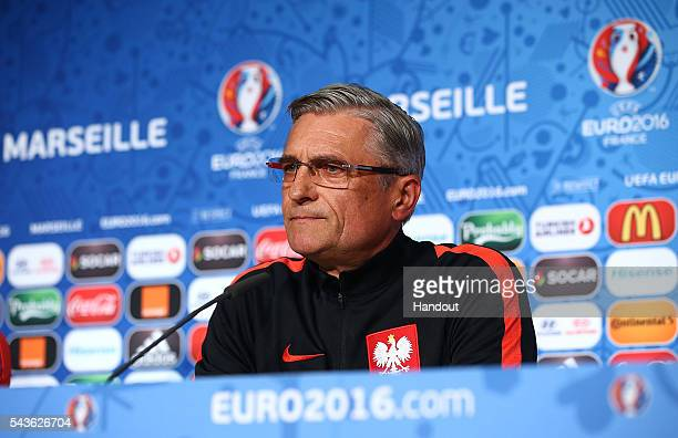 In this handout image provided by UEFA Poland coach Adam Nawalka faces the media during the Poland press conference at Stade Velodrome on June 29...