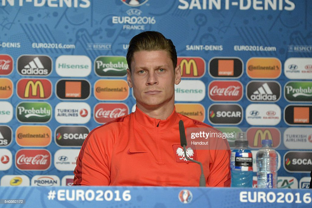 In this handout image provided by UEFA Poland player Lukasz Piszczek addresses the press during a Poland press conference on June 15, 2016 in Paris, France.