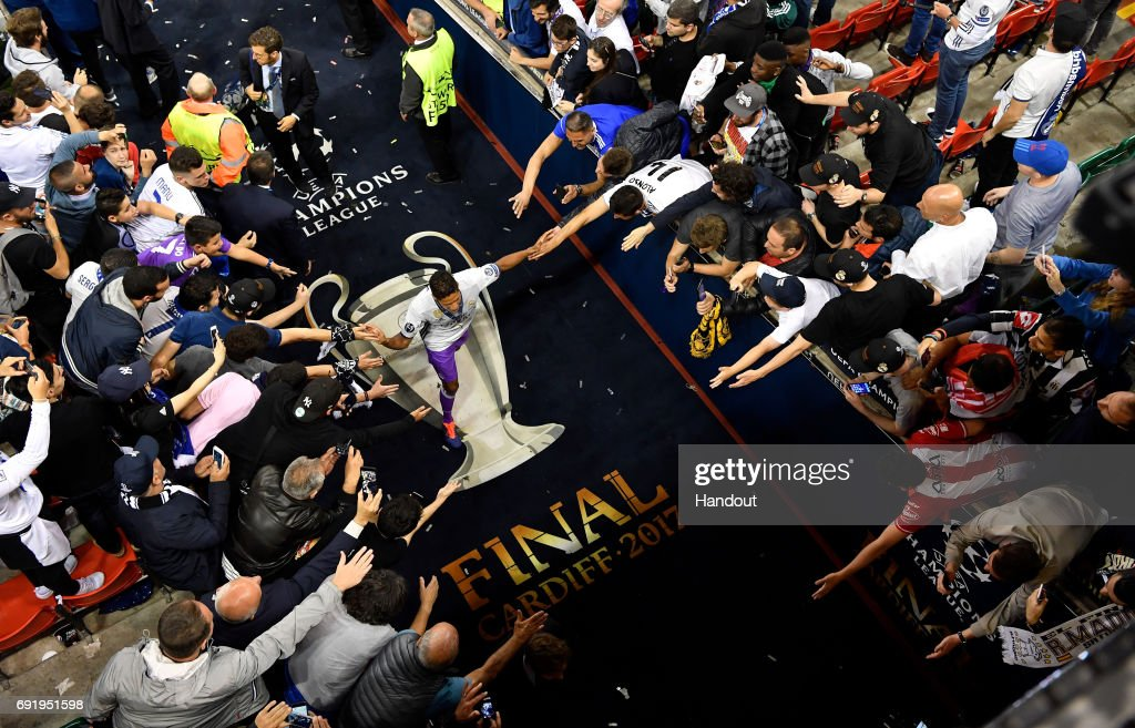 In this handout image provided by UEFA, Raphael Varane of Real Madrid walks down the tunnel after the UEFA Champions League Final between Juventus and Real Madrid at National Stadium of Wales on June 3, 2017 in Cardiff, Wales.