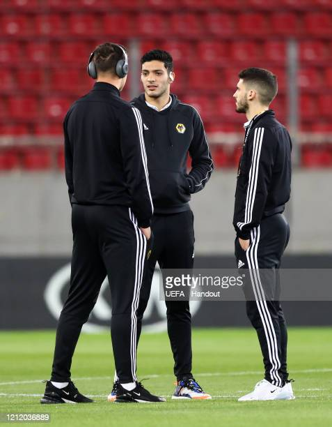 In this handout image provided by UEFA Raul Jimenez of Wolverhampton Wanderers speaks to his team mates on the pitch prior to the UEFA Europa League...