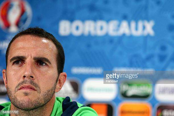 In this handout image provided by UEFA Republic of Ireland's player John O'Shea looks on during a press conference at Matmut Atlantique Stadium on...