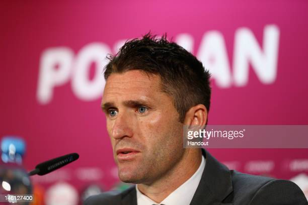 In this handout image provided by UEFA Robbie Keane of the Republic of Ireland talks to the press during a UEFA EURO 2012 press conference after the...