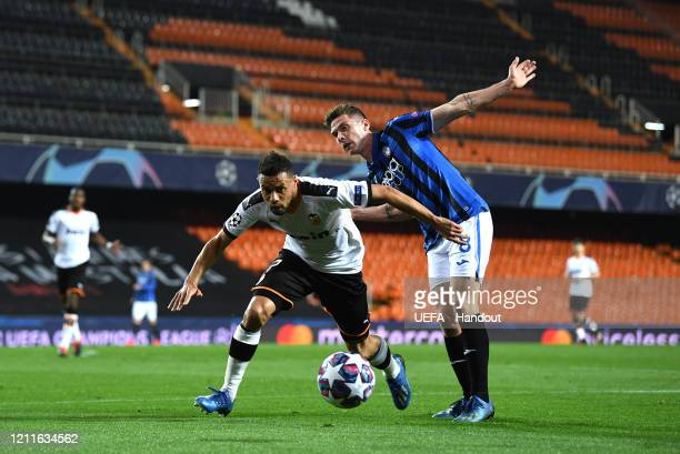 In this handout image provided by UEFA Robin Gosens of Atalanta battles for possession with Francis Coquelin of Valencia during the UEFA Champions...