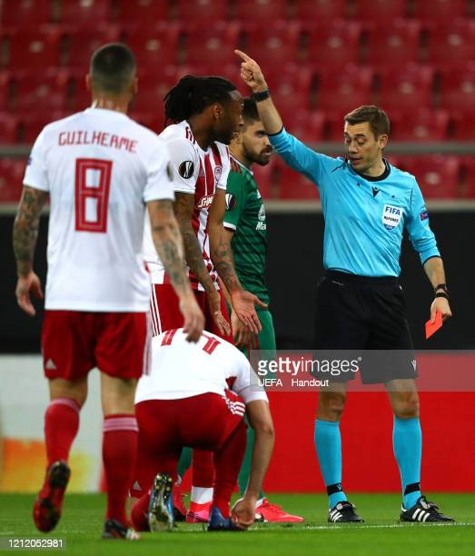 In this handout image provided by UEFA Ruben Semedo of Olympiacos FC is shown a red card by referee Clement Turpin during the UEFA Europa League...