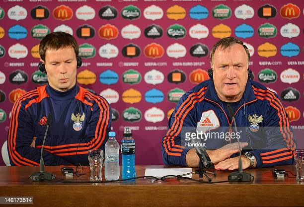 In this handout image provided by UEFA Russia coach Dick Advocaat and Konstantin Zyryanov talk to the media during a UEFA EURO 2012 press ahead of...