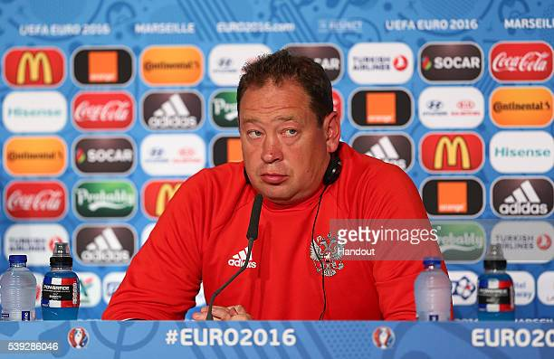 In this handout image provided by UEFA Russia head coach Leonid Sloutski faces the media during the Russia Press Conference on June 10 2016 in...