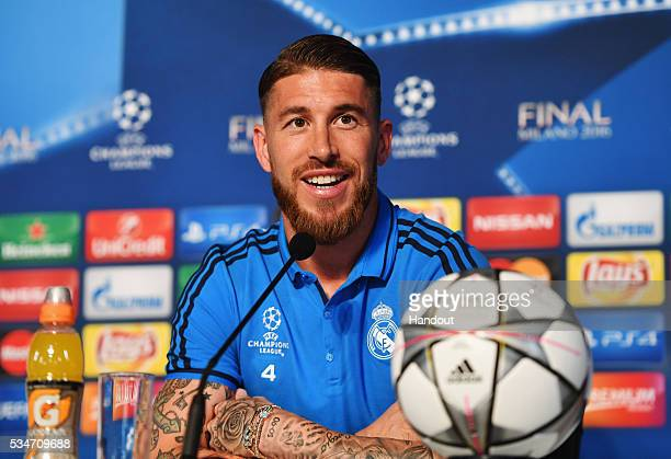 In this handout image provided by UEFA Sergio Ramos of Real Madrid talks to the media during a Real Madrid press conference on the eve of the UEFA...