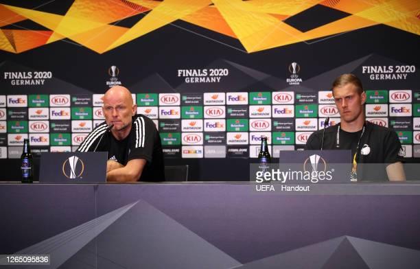 In this handout image provided by UEFA, Staale Solbakken, Manager of FC Kobenhavn and Karl-Johan Johnsson of FC Kobenhavn speak to the media during a...