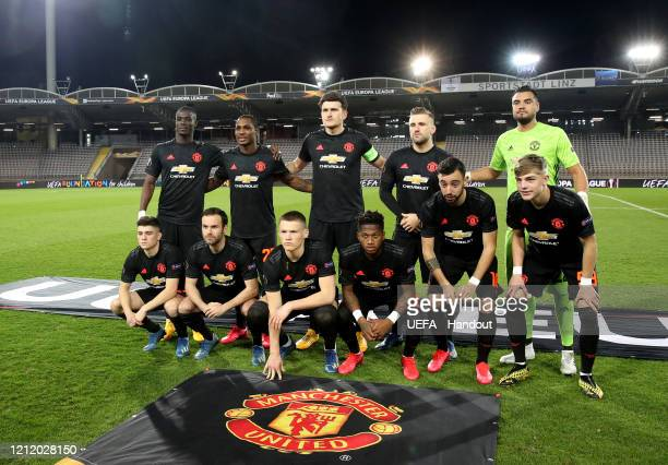 In this handout image provided by UEFA The Manchester United team line up prior to the UEFA Europa League round of 16 first leg match between LASK...