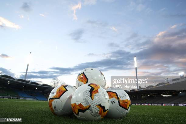 In this handout image provided by UEFA The match balls are seen on the pitch prior to the UEFA Europa League round of 16 first leg match between LASK...