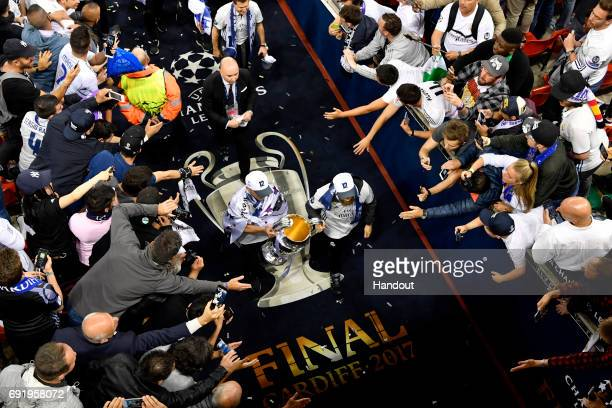 In this handout image provided by UEFA The trophy is carried back to the dressing room after the UEFA Champions League Final between Juventus and...
