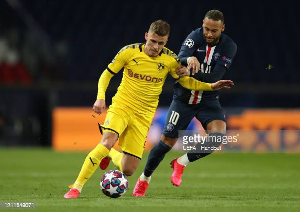 In this handout image provided by UEFA Thorgan Hazard of Borussia Dortmund is challenged by Neymar of Paris SaintGermain during the UEFA Champions...