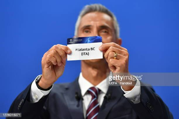 In this handout image provided by UEFA UEFA Champions League Ambassador Paulo Sousa draws out the name of Atalanta BC during the UEFA Champions...