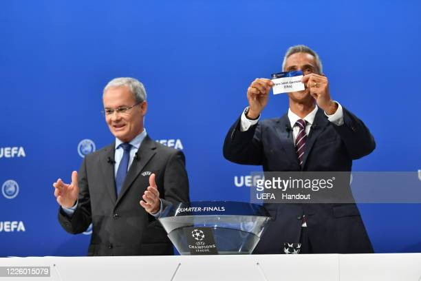 In this handout image provided by UEFA UEFA Champions League Ambassador Paulo Sousa draws out the name of Paris SaintGermain during the UEFA...