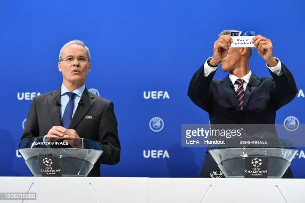 In this handout image provided by UEFA UEFA Champions League Ambassador Paulo Sousa draws out the card of 'Winner of quarterfinal 4' during the UEFA...