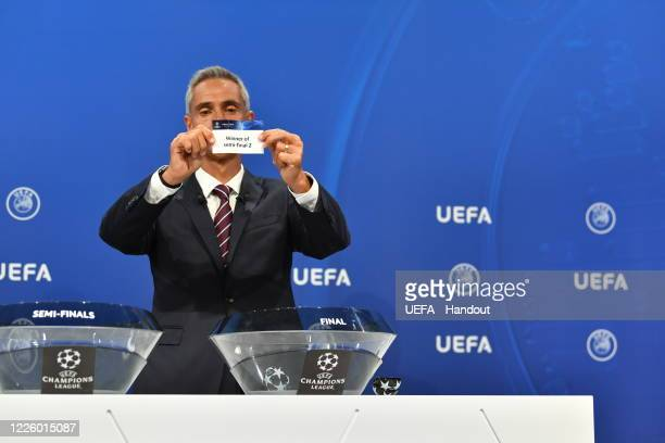 In this handout image provided by UEFA UEFA Champions League Ambassador Paulo Sousa draws out the card of 'Winner of semifinal 2' during the UEFA...