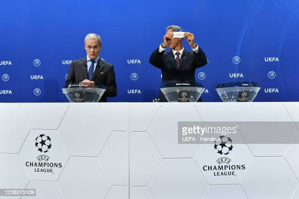 In this handout image provided by UEFA UEFA Champions League Ambassador Paulo Sousa draws out the card of 'Winner of quarterfinal 2' during the UEFA...