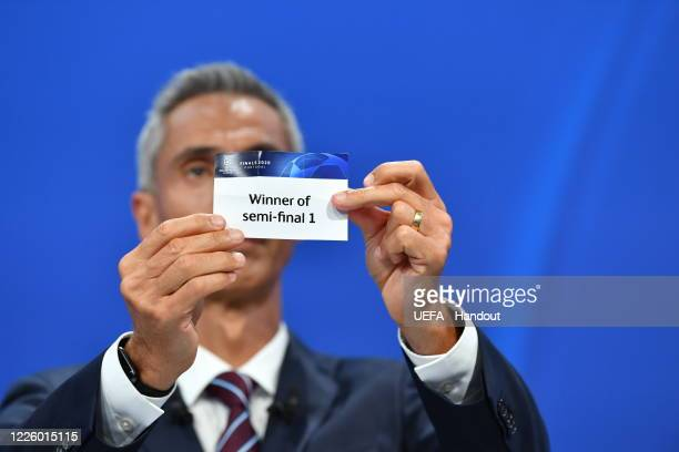 In this handout image provided by UEFA UEFA Champions League Ambassador Paulo Sousa draws out the card of 'Winner of semifinal 1' during the UEFA...