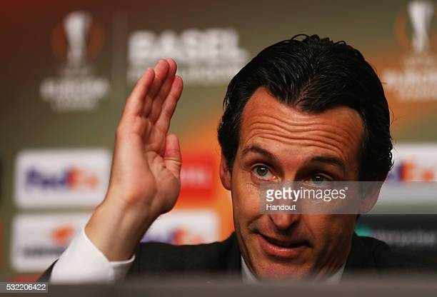 In this handout image provided by UEFA Unai Emery coach of Sevilla attends a press conference after the UEFA Europa League Final match between...