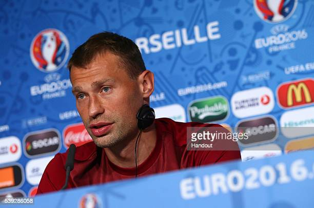 In this handout image provided by UEFA, Vasili Berezutski faces the media during the Russia Press Conference on June 10, 2016 in Marseille, France.