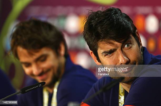 In this handout image provided by UEFA, Vedran Corluka and Niko Kranjcar of Croatia talk to the media during a UEFA EURO 2012 press conference ahead...
