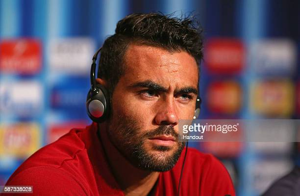 In this handout image provided by UEFA Vicente Iborra talks to the media during the Sevilla Press Conference at Lerkendal Stadion on August 8 2016 in...