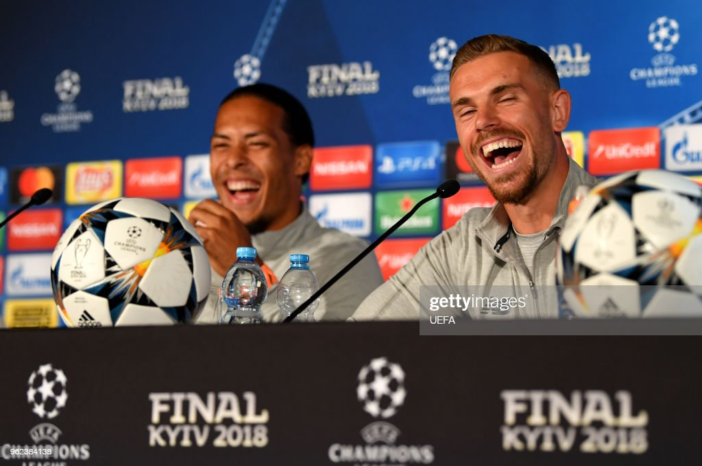 In this handout image provided by UEFA Virgil van Dijk and Jordan Henderson of Liverpool laugh during a Liverpool press conference ahead of the UEFA Champions League Final against Real Madrid at NSC Olimpiyskiy Stadium on May 25, 2018 in Kiev, Ukraine.