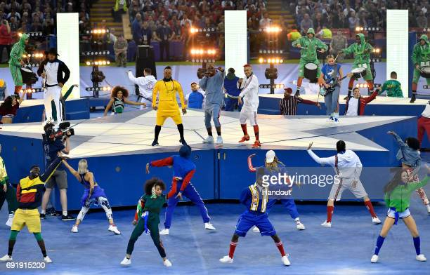 In this handout image provided by UEFA william apldeap and Taboo of The Black Eyed Peas perform prior to the UEFA Champions League Final between...