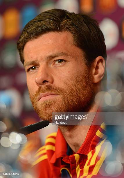 In this handout image provided by UEFA Xabi Alonso of Spain talks to the media during a UEFA EURO 2012 press conference at the Municipal Stadium on...