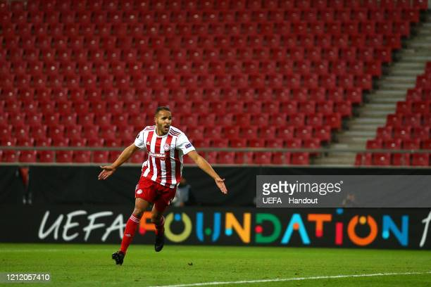In this handout image provided by UEFA, Youssef El Arabi of Olympiacos FC celebrates after scoring his team's first goal during the UEFA Europa...