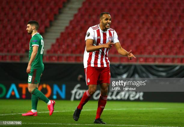 In this handout image provided by UEFA Youssef El Arabi of Olympiacos FC celebrates after scoring his team's first goal during the UEFA Europa League...