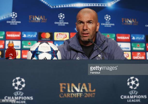 In this handout image provided by UEFA Zinedine Zidane coach of Real Madrid talks during a press conference prior to the UEFA Champions League Final...