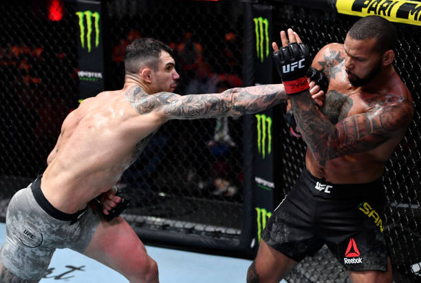In this handout image provided by UFC, Aleksandar Rakic of Austria punches Thiago Santos of Brazil in their light heavyweight fight during the UFC...