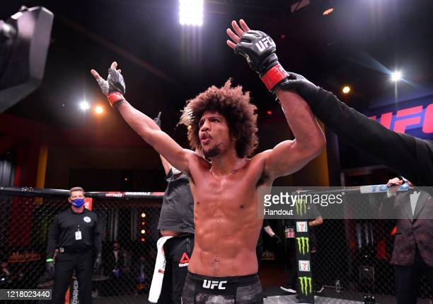 In this handout image provided by UFC Alex Caceres celebrates after his victory over Chase Hooper in their featherweight bout during the UFC 250...