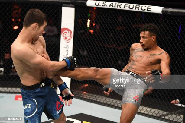 In this handout image provided by UFC, Alex Oliveira of Brazil kicks Shavkat Rakhmonov of Kazakhstan in their welterweight bout during the UFC 254...