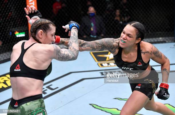 In this handout image provided by UFC, Amanda Nunes of Brazil punches Megan Anderson of Australia in their UFC featherweight championship fight...
