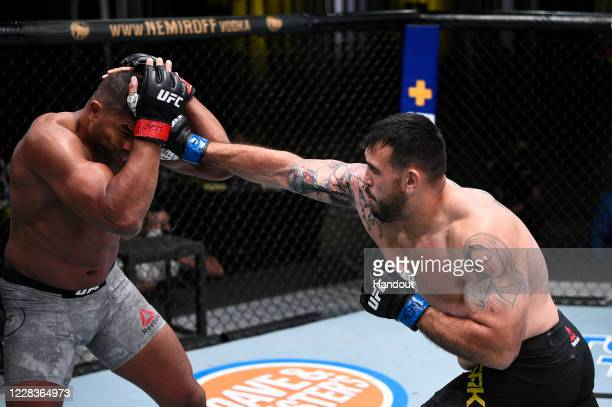 In this handout image provided by UFC, Augusto Sakai of Brazil punches Alistair Overeem of the Netherlands in a heavyweight fight during the UFC...