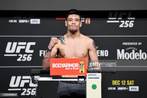 In this handout image provided by UFC, Brandon Moreno of Mexico poses on the scale during the UFC 256 weigh-in at UFC APEX on December 11, 2020 in...