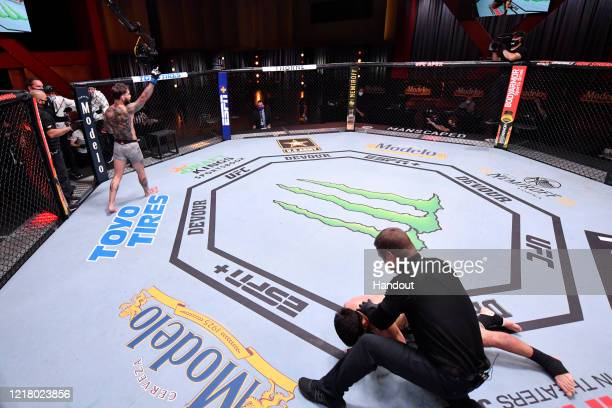 In this handout image provided by UFC Cody Garbrandt celebrates after his knockout victory over Raphael Assuncao of Brazil in their bantamweight bout...