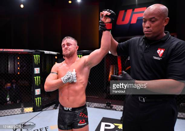 In this handout image provided by UFC Cody Stamman celebrates after his victory over Brian Kelleher in their featherweight bout during the UFC 250...