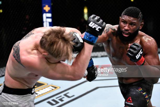 In this handout image provided by UFC, Curtis Blaydes punches Alexander Volkov of Russia in their heavyweight bout during the UFC Fight Night event...