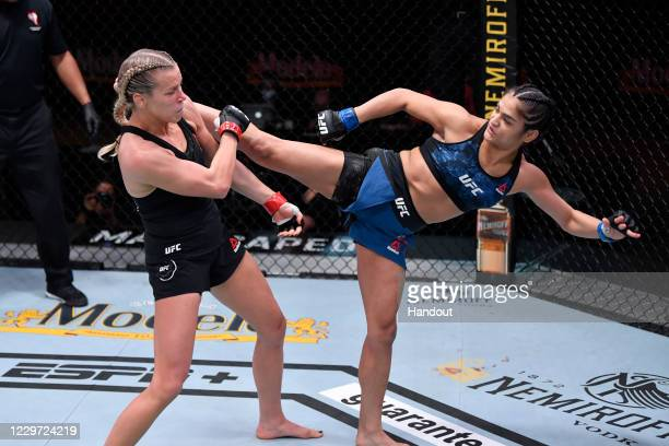 In this handout image provided by UFC, Cynthia Calvillo kicks Katlyn Chookagian in their women's flyweight bout during the UFC 255 event at UFC APEX...