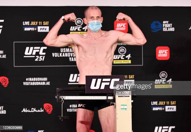 In this handout image provided by UFC, Danny Henry of Scotland poses on the scale during the UFC 251 official weigh-in inside Flash Forum at UFC...