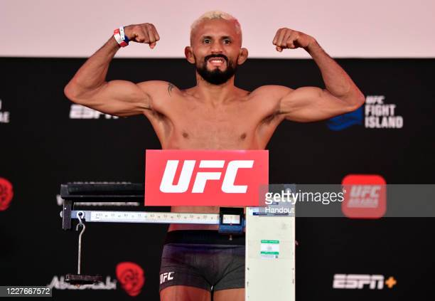 In this handout image provided by UFC Deiveson Figueiredo of Brazil poses on the scale during the UFC Fight Night weighin inside Flash Forum on UFC...