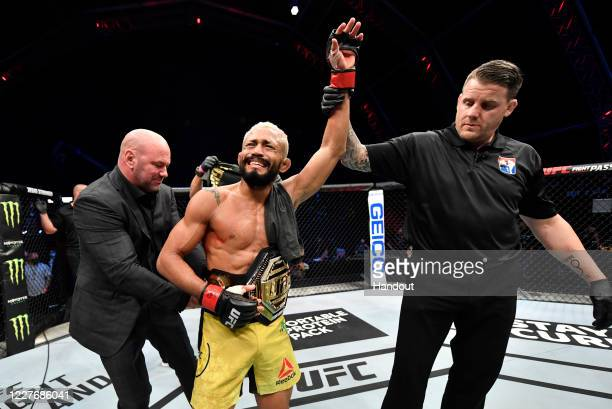 In this handout image provided by UFC Deiveson Figueiredo of Brazil celebrates after defeating Joseph Benavidez in their UFC flyweight championship...