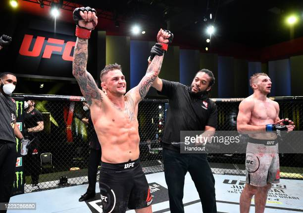 In this handout image provided by UFC Dustin Poirier celebrates after his victory over Dan Hooker of New Zealand in their lightweight fight during...