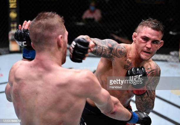 In this handout image provided by UFC Dustin Poirier punches Dan Hooker of New Zealand in their lightweight fight during the UFC Fight Night event at...