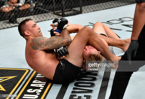 In this handout image provided by UFC, Fabricio Werdum of Brazil works to secure an arm bar submission against Alexander Gustafsson of Sweden in...