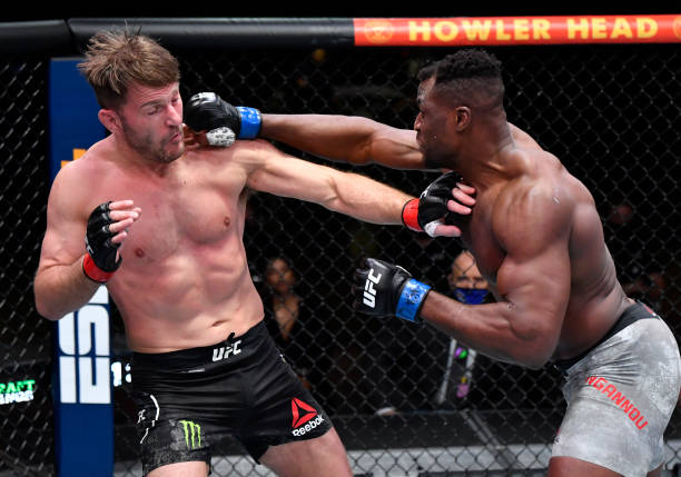 In this handout image provided by UFC, Francis Ngannou of Cameroon punches Stipe Miocic in their UFC heavyweight championship fight during the UFC...