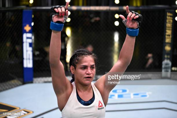 In this handout image provided by UFC, In this handout image provided by UFC, Cynthia Calvillo after the conclusion of her flyweight fight against...